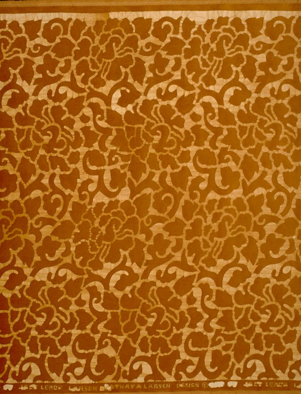 """Cotton velvet batik with scroll and floral design, forground in brown. Vertical pattern repeat at 16"""", horizontal repeat at 23 1/2. Beige bkg. With rust.. Terra Cotta"""