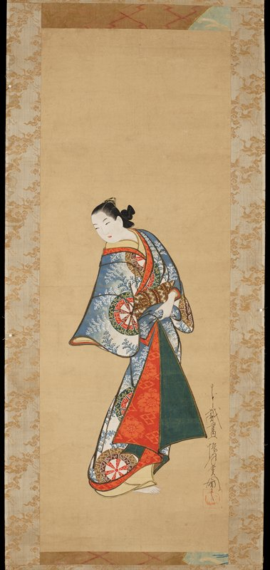 Female figure wearing layered robes. Outermost robe features design of wheels over a blue and white ground with ferns. Undergarments are red, green, and ochre.