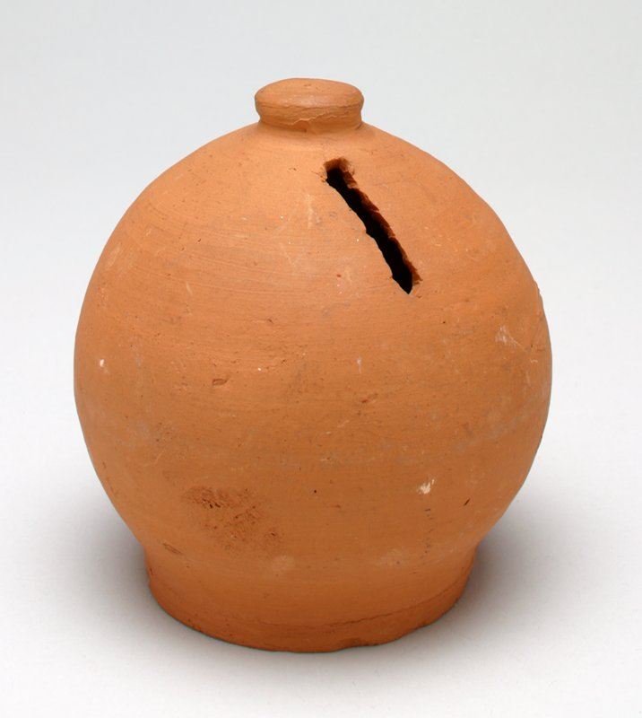 brown ceramic sphere with a flattened disc at the top; unglazed and undecorated;
