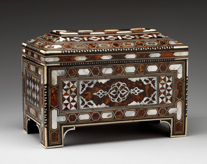 rectangular form on bracket feet; hinged beveled cover; inlay overall with central palmette medallion with pendant element and corner pieces with cartouche borders; side with trefoils forming trellis pattern with similar borders