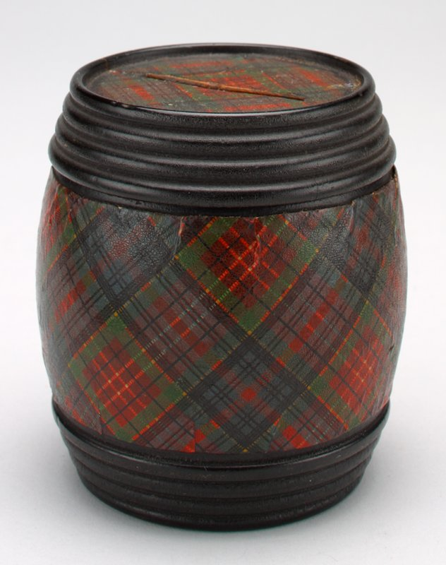 plaid: green, red, black and light yellow; whiskey barrel shape with four black ribs; wooden trip on top and bottom; slot on top; bottom white and black;