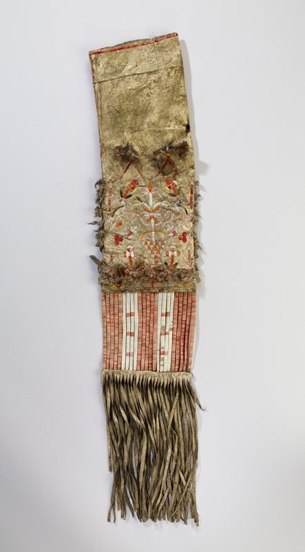 rectangular pouch with long fringe, partially covered in red and white quills; front quilled design of flowers in a basket; red lines and red, pink and white square on back; red feather accents