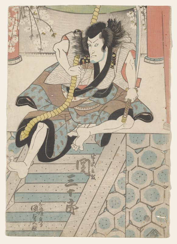 man with flowing hair swinging on a yellow rope at the top of a flight of stairs, holding his sword in his PL hand; man wears garments that are blue with grey patterning, solid grey, solid black, and white with light grey linear patterning; pink columns at left and right edges at top; some white blossoming branches at top; grey and blue stairs and hexagonal patterns in grey and blue at bottom