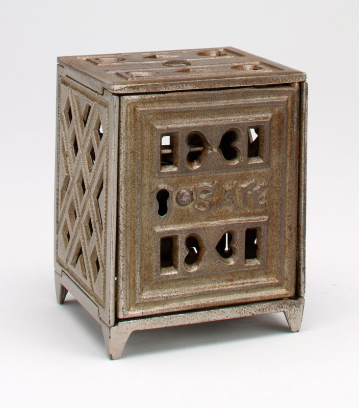 silver metal block shape safe; open work hearts and diamonds motif on top, hearts on door, diamonds on sides and back; coin slot in back; hearts on bottom