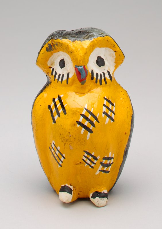 black and yellow ceramic owl; red beak, large white eyes; coin slot in top of head