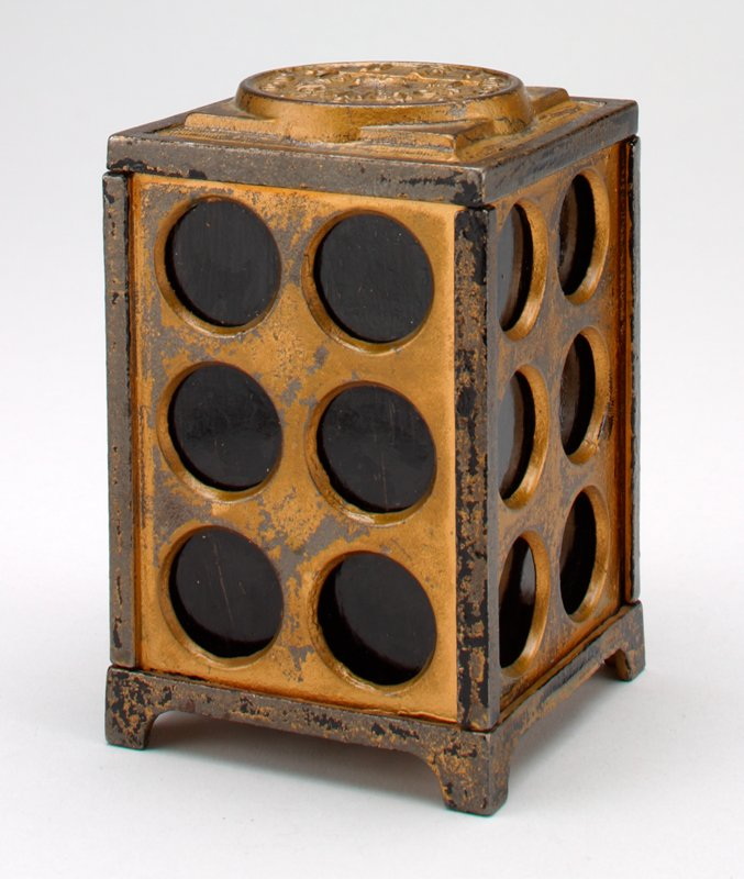 """rectangular metal box bank on 4 feet colored gold and black; 6 7/8"""" circles cut into each side; on top is a clock face with hands pointing to 12:00 and """"12:00 M Washington"""" printed in center"""