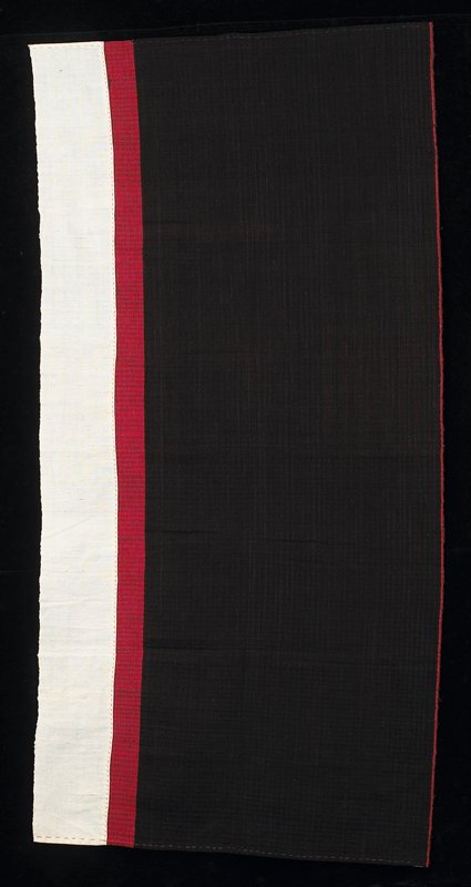 black cloth with a red band and a white band at bottom; black area is comprised of small squares nearly transparent; red and white bands are solid; thin red band at top; stitching is visible at sides and top of white area
