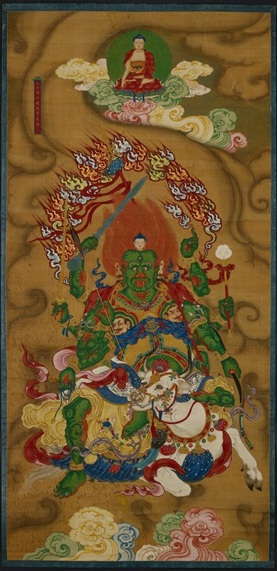 Seated Buddha at top center with pink, yellow and green clouds; green demon figure with eight arms seated on a white cow at bottom; arc of white and yellow flames above demon; gold frame; glazed with plexiglass
