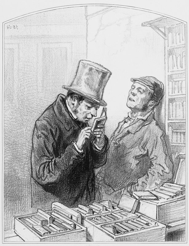 man wearing a top hat and overcoat, looking at a small book; other books in bins on table in front of man; second man, wearing a cap, leans against wall at R