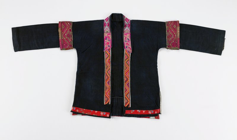 jacket has open front; two kinds of braid with embroidered pink, red and green patches; red printed fabric strips on front bottom edge; woven red and tan band on sleeve back and around upper arm; sequins on upper arm; bottom back has applique with embroidered flowers in red, green and pink