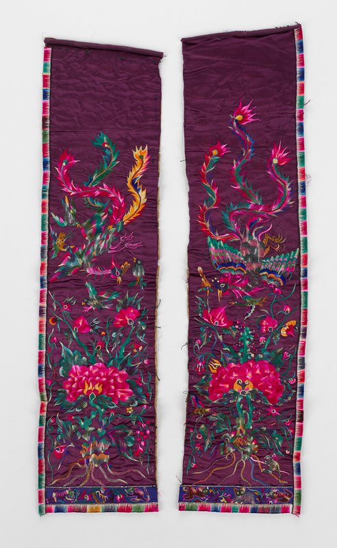 2 separate purple panels, elaborately embroidered with birds and flowers in multi bright colors; outside borders embroidered; bottom, horizontal strip of embroidered animals; finished embroidery on paper background