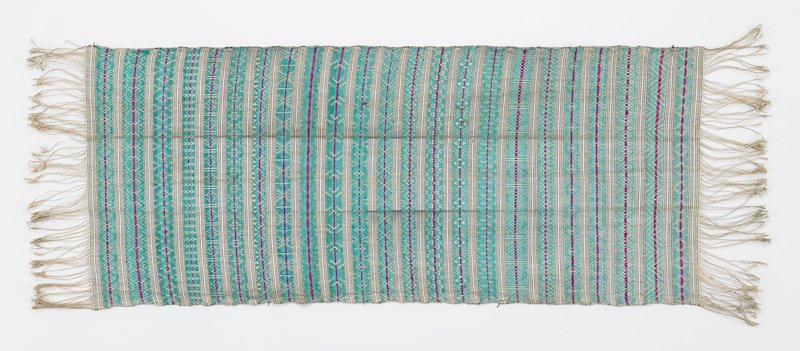 """blue-green with red; 1/2""""-1"""" woven bands separated by 3/8"""" wide black and white woven strips; 3""""-3-1/2"""" warp fringe at both ends; fringe knotted at very end"""
