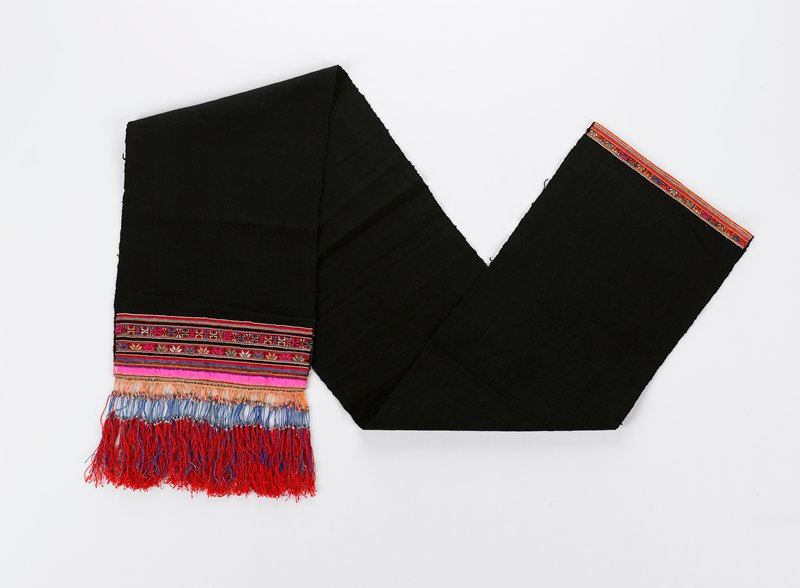 "black; one end has narrow bands of cross stitch and applique in red, pink, green and blue ending in 6"" of intricately formed tassels; 5 3/4""; red, blue and gold with tiny metal beads; other end has a 3/4"" band of embroidery"