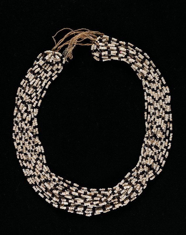 sixteen strands of white shell beads mixed with black glass beads and scattered pink beads; twisted ramie cords at ends