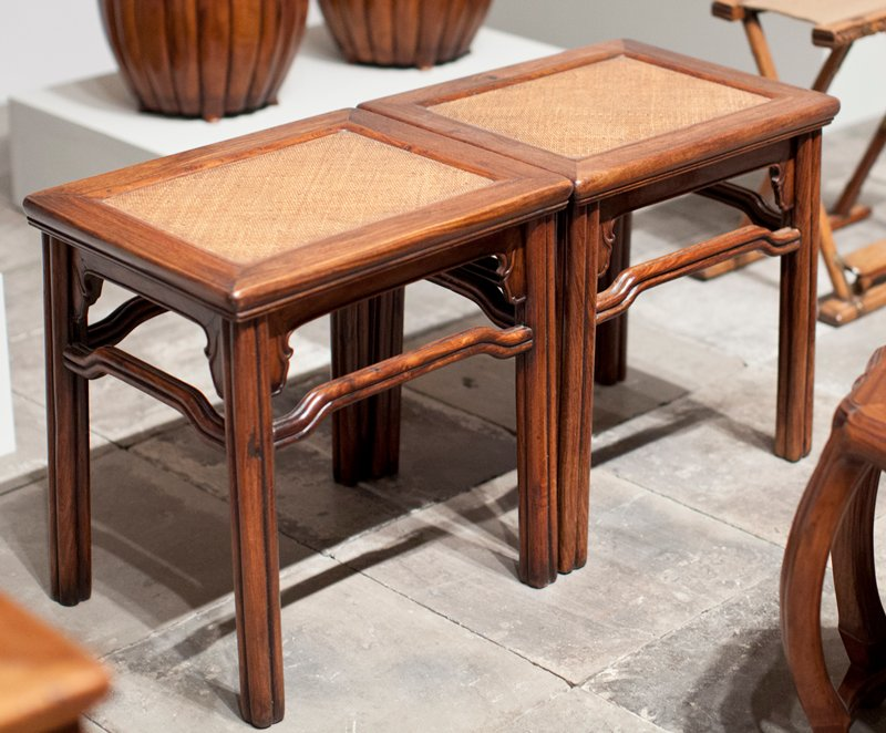 huang hua-li rectangular stool; mat seat; four reeds joined form design of legs and horizontal supports organic leaf design at apron corners; double bead under seat frame