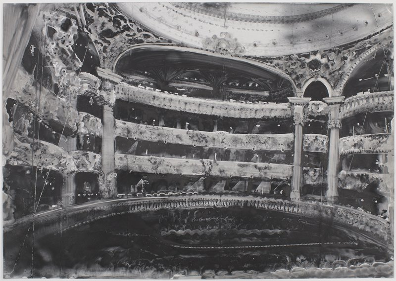 view from the stage in an elaborately decorated theater; shades of grey, black and white