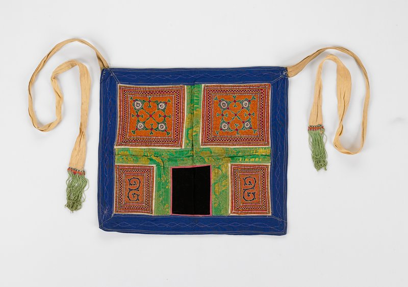 four totally embroidered rectangles with Arabic style design in orange, green and blue; bright green damask with silver stitching borders the embroidered rectangles and black velveteen rectangle; blue border and lining with silver stitching; cream ties with green tassels
