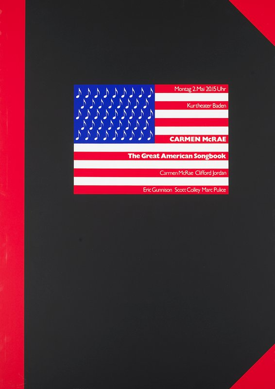 American flag with song notes in place of stars; on black background with red along L edge and in UR and LR corners; black metal frame