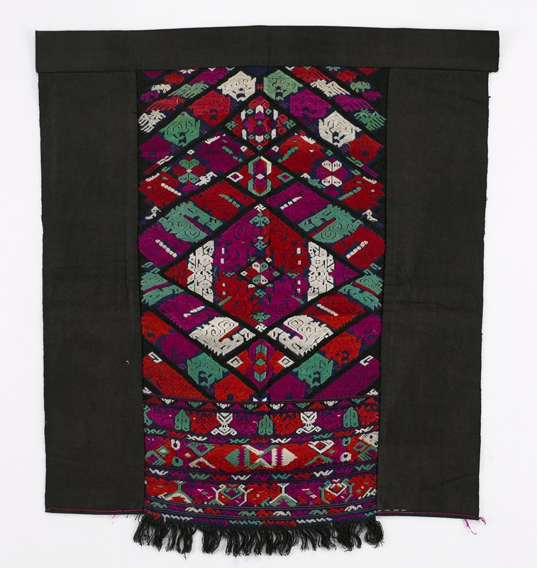 black with purple, red, green, white; two solid black side panels with center fringed panel of satin stitched, colorful embroidery of floral and geometrics; long embroidery floats