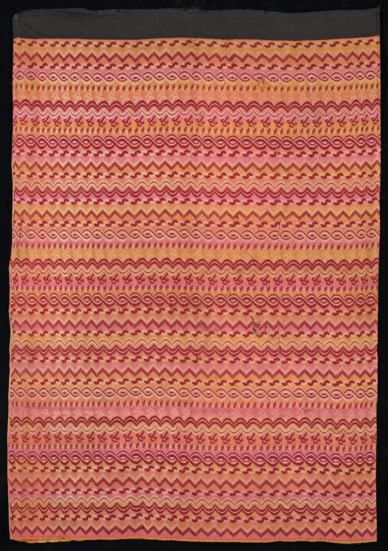 overshot (false Luntaya); pink and yellow plaid center panel with repeating horizontal patterns on balance of skirt; red predominates; mounted on black waistband