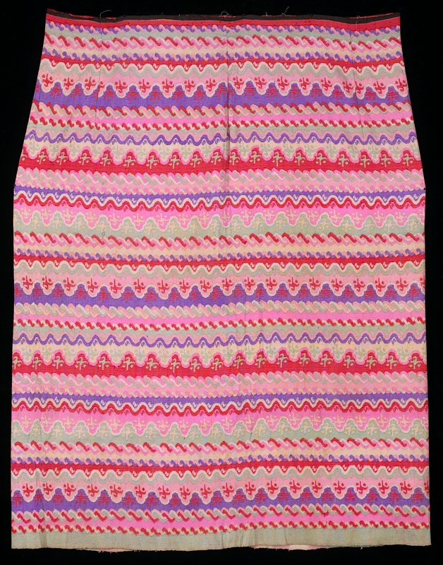 """wavy horizontal designs in repetitive rows of purple, pink, Chinese red and green; 1/2"""" remnant of black cotton waistband; thick silk; 6 darts at waistband; center back strip has pink and cream vertical stripes"""