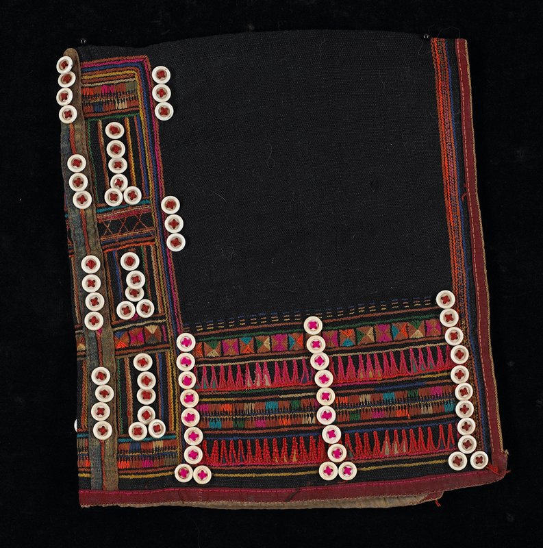 black; back and sides have rows of embroidery and stitching, some geometric; accented with solid rows of white buttons; pink, orange, green, blue