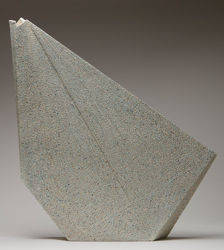 wedge-shaped; various shallowly-incised lines; light blue, medium blue, dark blue, yellow, pink, white and brown flecks overall