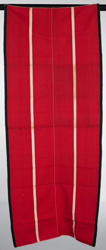 warp face, plain weave; red with black edges through length; two white stripes run the length dividing the design into thirds