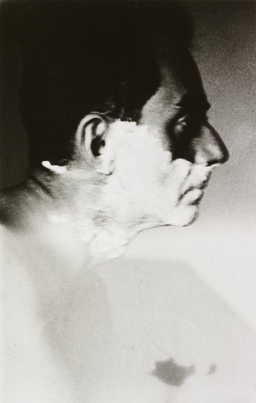 Man Ray in profile from PR, with shaving cream on his face