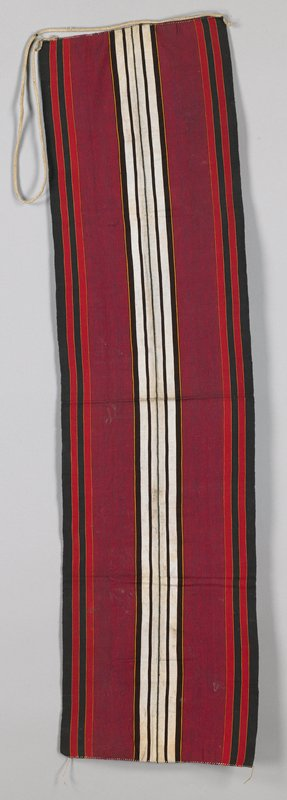 """red with black and white; wide band; warp-faced, plain weave in 1/2""""-2-3/4"""" wide stripes; braided strap at one end; overcast both ends"""