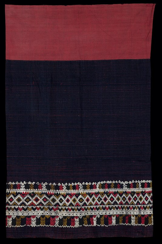 """red, black, navy and gold; wide, rose colored band; red, blue/ black stripes with supplementary weft patterning, 7 1/4"""" wide; one seam; patterns include: diamonds, stripes, chevrons and trees (?); worn with selvedge edge along bottom"""