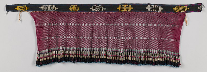 "black and maroon with supplementary weft designs on top, 1 3/4"" woven band; braided open work 8 1/2"" wide; hanging from braid are tassels that are wrapped and beaded with long, white metal beads and tiny, blue seed beads; all tassels are the same color"