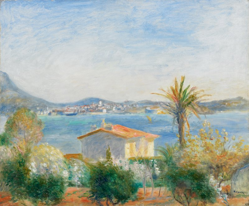 view of trees, including one tall palm tree, and building with orange roof on near shoreline; calm water; white buildings with bright roofs on opposite bank