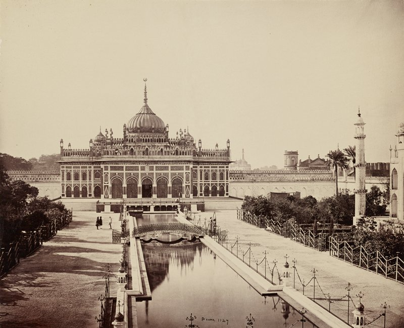 central domed building with spires and arches; canal center foreground to building; bridge across canal; three figures at L between bridge and building; leaf from a portfolio (?)
