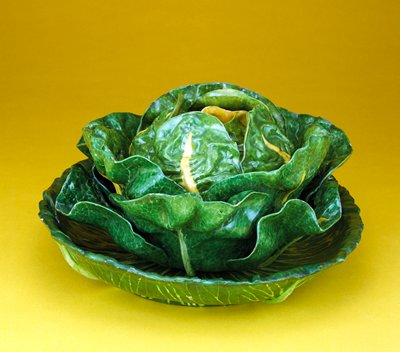 cabbage tureen, cover and stnad; porcilain in green glaze of verying tones; veining in yellow and green, younger leaves in yellow
