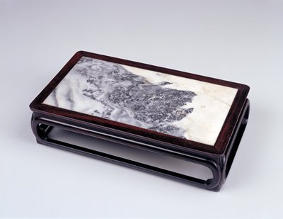 dark wood rectangular stand with open sides topped with grey and white marble