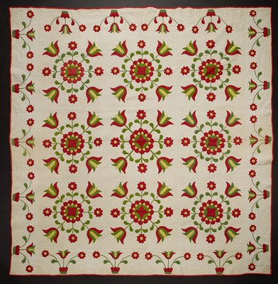 white backing and white ground with red trim; red and green solid and yellow print appliquéd floral medallions and blooming potted floral trim